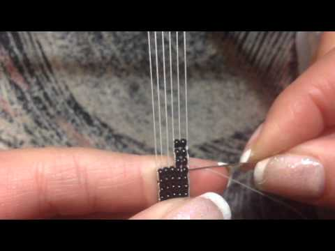 Making a button hole on a bead loom.