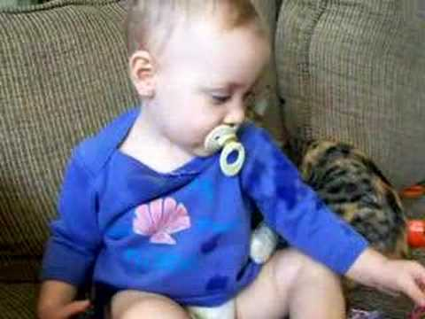 Cat Nursing on Sleepy Baby