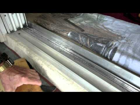 Home Repairs - 8 ft sliding door track repair