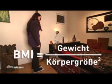 Woman taking her height, weight and BMI