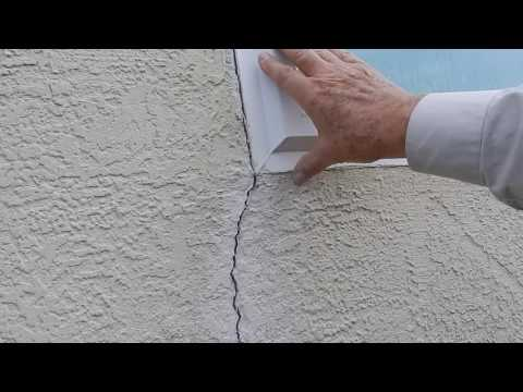 Stucco wall & small crack at window explanation.