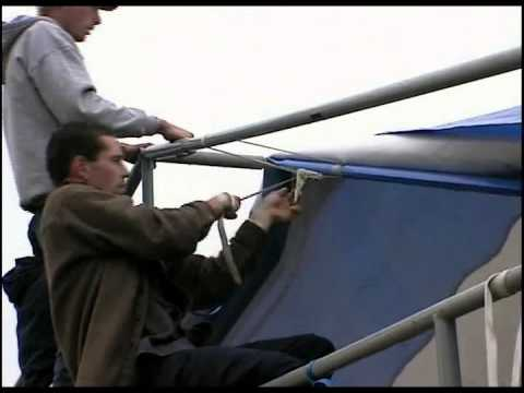 ChinookStalls.com - Step 8 Putting tarp on roof frame