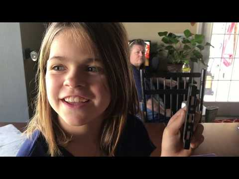 Kids guess how to use an audio cassette tape