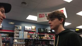 KID GETS SO MAD HE BEATS HIS FRIENDS UP IN GAMESTOP!!!!!!! MUST WATCH!!!!!!
