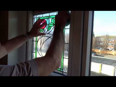 Applying Peels of London stained glass window film to your window.