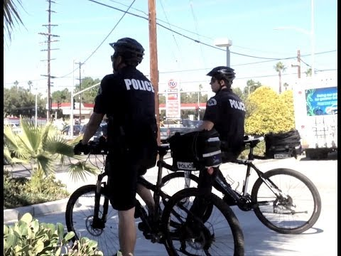 LAPD Bicycle Officers Ticket Two Cell Phone Drivers in 3 Minutes.