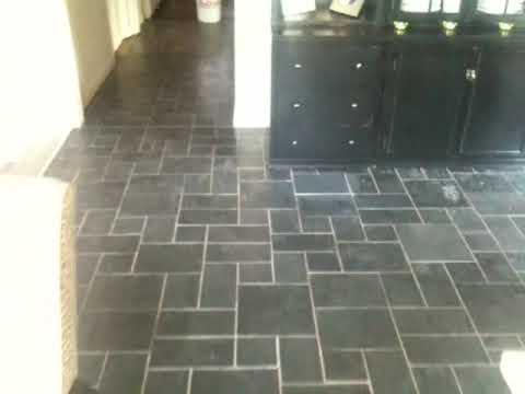 Slate floor w/polyurethane sealer  BEFORE with sample area stripped