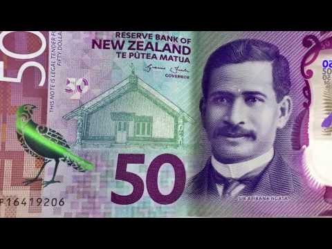 Extreme detailed view of New Zealand money notes coins and security features 2160p 4k UHD