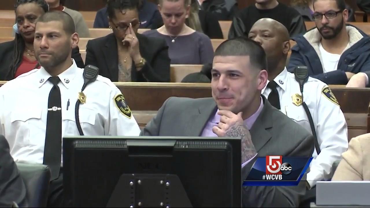 Hernandez smiles during murder trial as friends testify