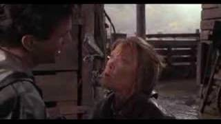 """Some clips from the movie """"The river"""" (1984), featuring some people (Mel Gibson among them) in rainwear, water, and mud."""