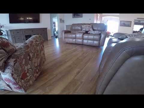 Laminate over hardwood