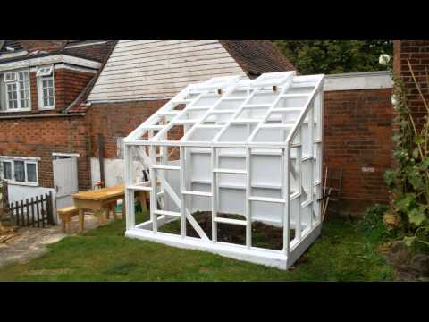 Building a glass-walled wooden lean-to greenhouse