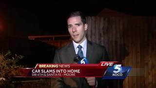 Car crashes through fence, slams into Moore home