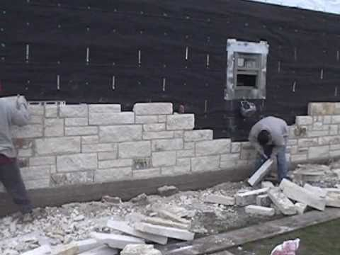 Masonry, installing the limestone exterior walls