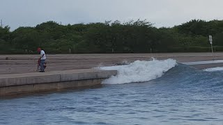 Ship causes rogue wave to go over wall