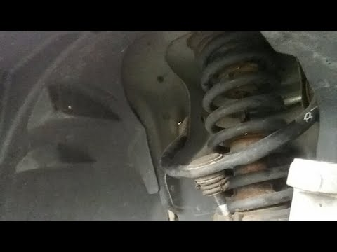 2006 Jeep Grand Cherokee control arm replacement  part 2