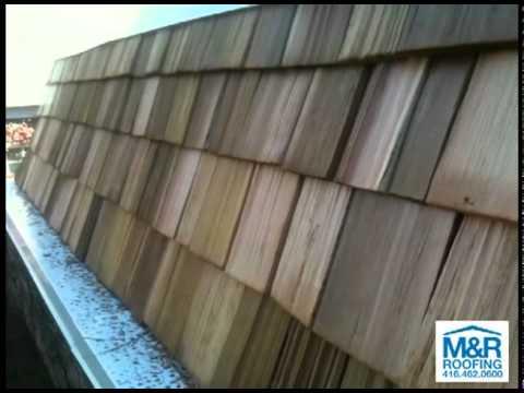 Cedar shakes on mansard roof in Toronto.