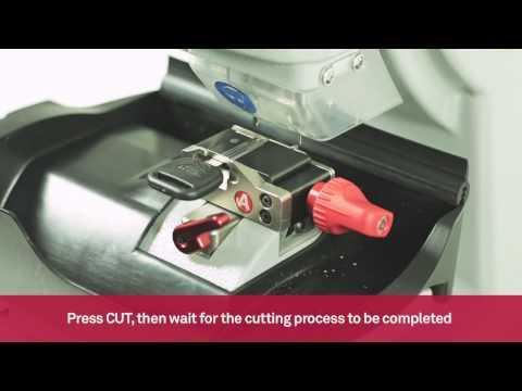 Electronic key cutting machine for decoding and cutting automotive laser keys | Keyline 994 Laser