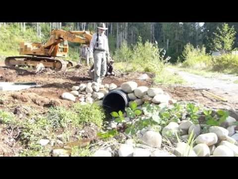 Building a Rock Headwall for Culvert in Three Minutes...