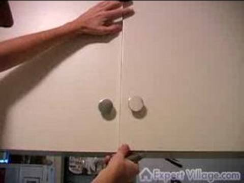 Tips for Remodeling Your Home : How to Remove Old Paint on Cabinets