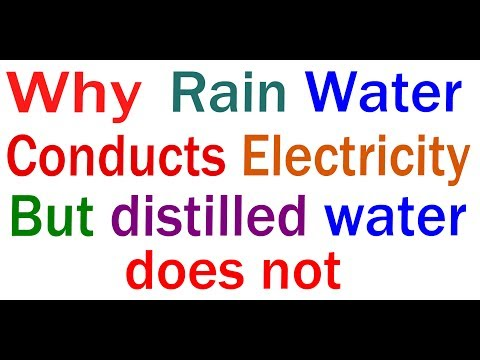 Why rain water conducts electricity but distilled water does not?
