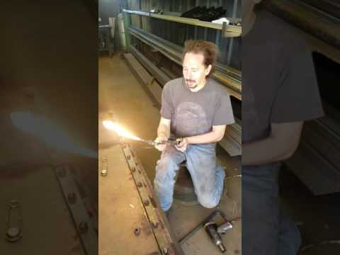 How to remove a rusted bolt by heating it with a torch.