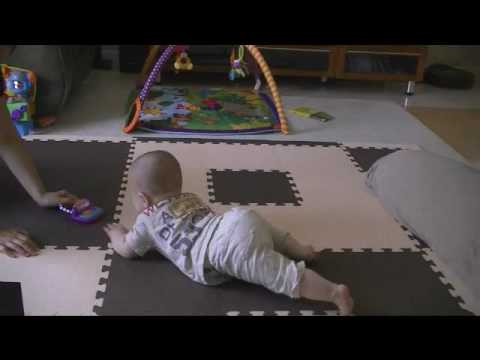 Baby Crawling on Floor 8 Months old:  Eriko was trying to get Aden, her son, to crawl more