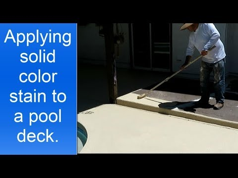 Applying H&C Colortop solid color stain to a concrete pool deck and patio.