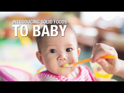 Introducing solid foods to baby.
