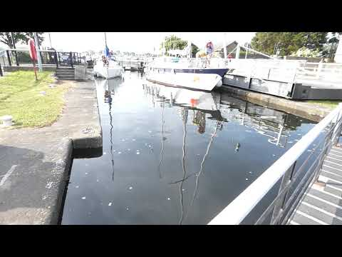 Sailing yacht boats in Glasson Dock lock system Lancaster England UK