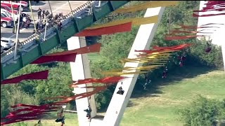 Greenpeace activists dangle from Houston bridge in protest of fossil fuel industry