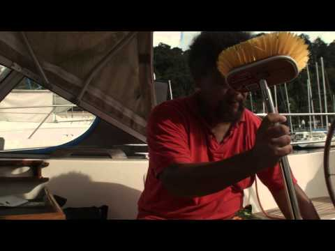 Cleaning the boat's teak deck