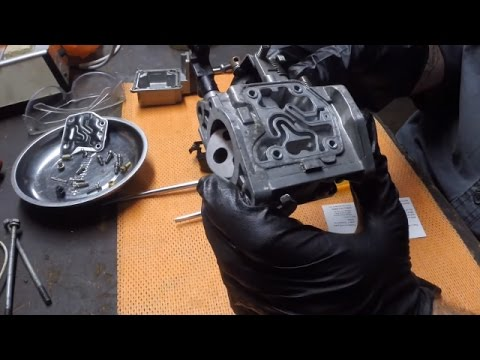 Cleaning a carburettor from an outboard motor