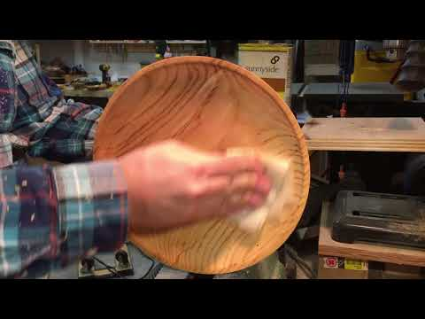 Applying boiled linseed oil to an ash bowl