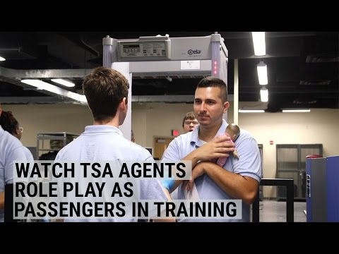 TSA Agents Line Up And Go Through Security As They Role-Play Passengers