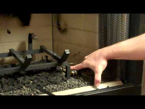 How to light the pilot on a vented gas log set.