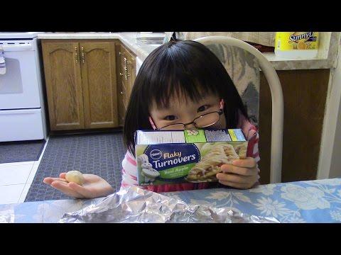 Emma makes Pillsbury Flaky Real Apple Turnovers.  Feb20_2016