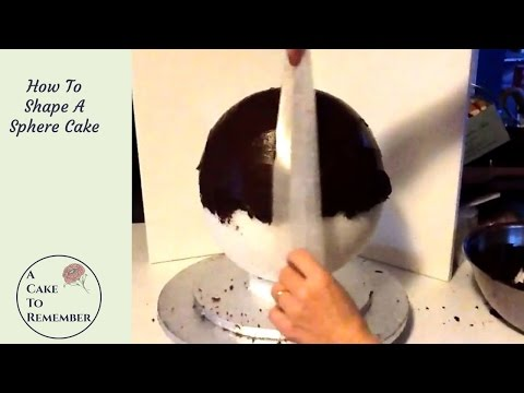 How to shape a sphere cake to make a globe cake.  Cake decorating tutorial for a round cake.