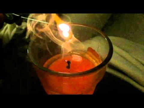 Traveling flame - Relight candle from smoke slow motion