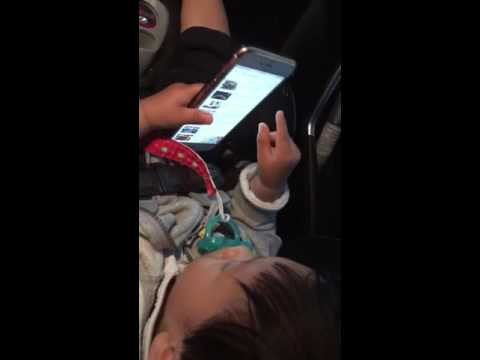 Sergio knows how to use iPhone and play YouTube by age one ==