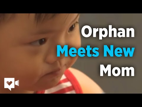 Watch how this orphan reacts when she meets her new 'momma'