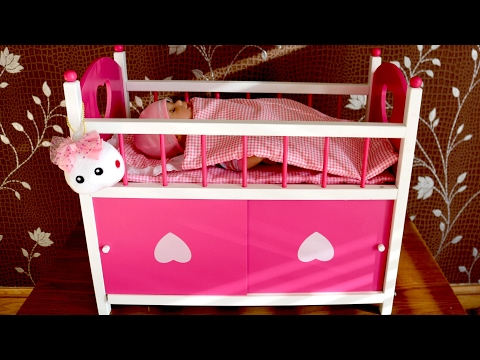 Baby Annabell's Dimples Cot Bed with Storage and Doors! Little girl sends 8 Baby Dolls Go to Bed!