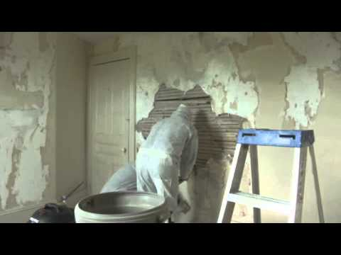 Tearing out plaster from an old 100 year old house