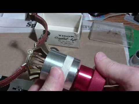 How I remove a crystal from a Bulova watch with crystal lift tool, part 1.