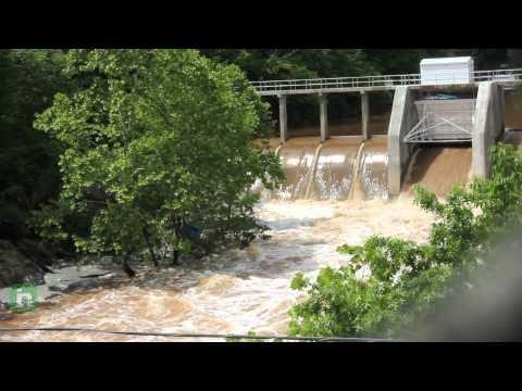 Water flowing through Lake Jackson Dam in Lake Jackson, Virginia following heavy rain