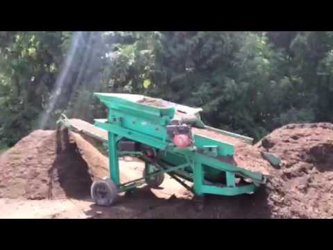 Screening horse manure, leaf compost and mulch fines