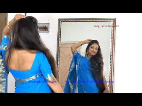 Indian Long Hair Beauty Playing with Her Long Tresses