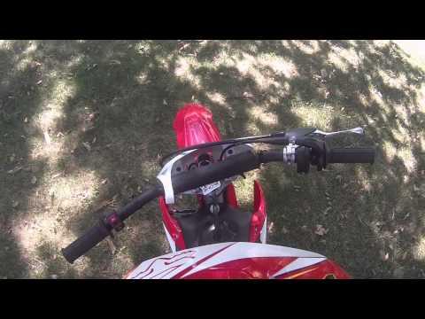 Honda CRF 110 dirt bike ridden by a child.