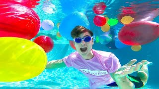 SWIMMING WITH GIANT WATER BALLOONS!! (UNDERWATER)