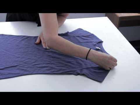 How to Asymmetrically Cut Off the Shoulder of a T-Shirt : Fashion Project